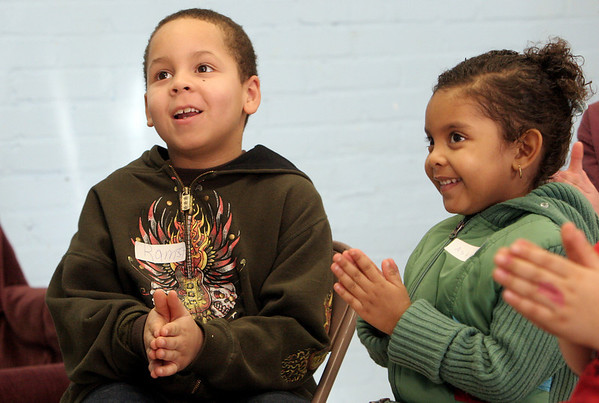 Gloucester: Ramsey Camilo, 7, and his sister Ashley Diaz, 3, clap their hands while singing a song at Cool Kids Club, a bible centered after school activity, at Riverdale Park Wednesday afternoon.  During this session the children learned that they should put the needs of others before their own. Mary Muckenhoupt/Gloucester Daily Times
