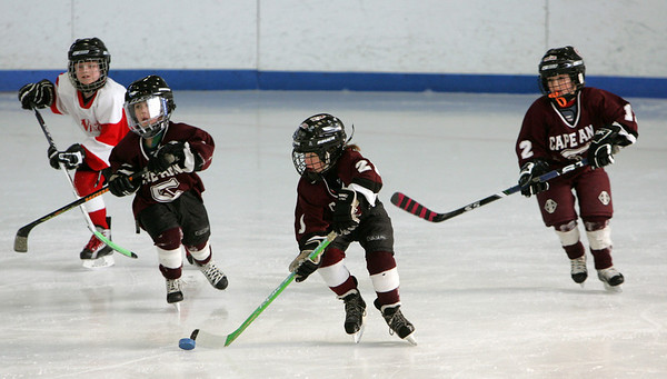 Gloucester: Harrison Marshall, center, of the Cape Ann mites skates down the ice while playing a team from Westmount, Quebec during the Sal Grasso Friendship Tournament at Dorothy Talbot Rink Saturday afternoon.  The Mites, ages 6 to 8, were the first to play Saturday followed by squirt, peewee and bantam players.  Mary Muckenhoupt/Gloucester Daily Times