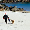 Manchester: Stella Price of Essex walks her dog Sunny along Singing Beach in Manchester on Tuesday afternoon. Sunny kept pulling her toward the water so he could go for a swim. Photo by Kate Glass/Gloucester Daily Times Tuesday, February 24, 2009