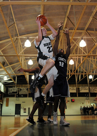 Manchester: Manchester Essex's Joe Mussachia leaps above Trinity Catholic's Golden Okonobah during the Division 4 North State Tournament at Manchester Essex High School last night. Photo by Desi Smith/Gloucester Daily Times Tuesday, February 24, 2009