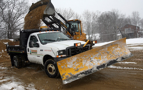Gloucester: Plow crews working for the City of Gloucester are loaded with sand at the DPW yesterday afternoon before heading out to battle yesterday's snow storm. Photo by Kate Glass/Gloucester Daily Times Tuesday, February 3, 2009