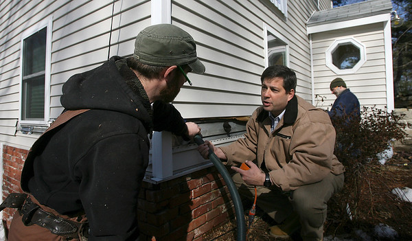 Gloucester: Senator Bruce Tarr, center, helps Pat Carron, left, and Paul Blanchard, right, of Cape Energy Solutions install blown insulation for a home on Uncas Road as part of the Energy Bucks initiative. The program helps lower income families weatherproof their homes to save money on fuel costs. It is sponsored by Action Inc., and National Grid and has been applied to over 100 homes on Cape Ann this winter. Photo by Kate Glass/Gloucester Daily Times Wednesday, February 11, 2009