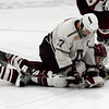 Arlington's Joe O'Hare sits on Gloucester's Nick Decoste while the puck is buried underneath him during their game at Veterans Memorial Rink in Arlington last night. Photo by Kate Glass/Gloucester Daily Times Wednesday, February 18, 2009