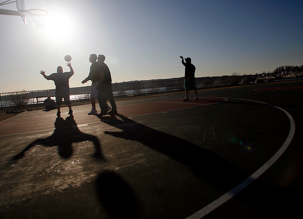 Gloucester: Mike Marschall, Brandon Jones, Nick Cooper, and Drew Elliott play basketball at the Paul F. Gemmelaro and Joseph L. Ciaramitaro Playground at Fort Square yesterday afternoon. The boys, who wore t-shirts and shorts, said it was a little cold, but they warmed up quickly. Photo by Kate Glass/Gloucester Daily Times Wednesday, February 25, 2009