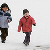 Manchester: Emily Schuh, 6, chases Bodin Jobe, 3, while playing at Masconomo Park Wednesday afternoon.  This was the first time the two had been to the park this winter because up until Wednesday the park was too snow covered to play at. Mary Muckenhoupt/Gloucester Dailey Times