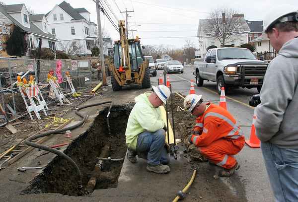 Gloucester: National Grid employees work on a pipe that will replace the cracked pipe infront of Wayne Sargent's house Thursday afternoon. Mary Muckenhoupt/Gloucester Daily Times