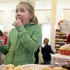 Essex: Evelyn Lantz, 10, chows down on a cupcake during the Valentine tea party held at the TOHP Burnham Library Friday afternoon.  Pastries and pink tea and juice were served as kids had fun socializing and play games as they celebrated Valentine's Day as well as the start of February Vacation. Mary Muckenhoupt/Gloucester Daily Times