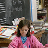 Rockport:  Sophia Cucciaro works on her painting of flowers in Simon Paddock's first and second grade art class Thursday afternoon. The class was working on finishing their pieces for the Rockport Public Schools Annula Art Show. The show will be held at The Rockport Art Association Tuesday, March 3rd through Sunday, March 8th with the opening reception Thursday, March 5th 6:30 to 8. Mary Muckenhoupt/Gloucester Daily Times
