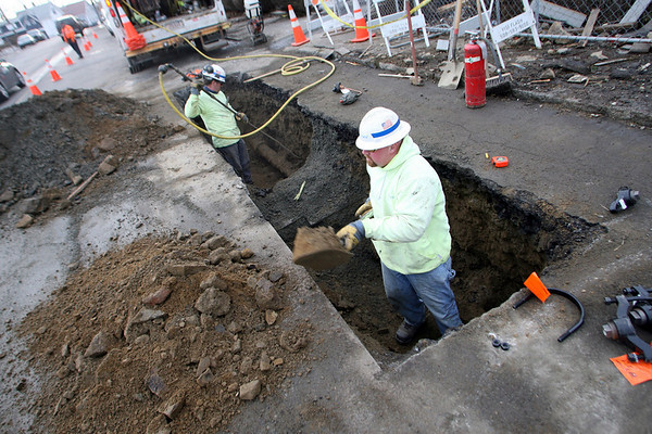 Gloucester: National Grid employees dig out the gas line that caused an explosion at 76 Eastern Ave last month. The crew will be removing the cracked pipe tomorrow. Photo by Kate Glass/Gloucester Daily Times Wednesday, February 11, 2009