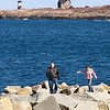 Rockport: Todd and Alexis Randall of Danvers walk across the rocks past Bearskin Neck on Tuesday afternoon. Both agreed the walk was bitterly cold because of the wind and were looking forward to getting hot chocolate at Helmuts Strudel to warm up. Photo by Kate Glass/Gloucester Daily Times Tuesday, February 24, 2009