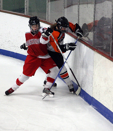 Gloucester: Masconomet's Jen Pino and Beverly's Liz Doherty battle for the puck during their 3-3 tie at the Talbot Rink in Gloucester last night. Photo by Kate Glass/Gloucester Daily Times Monday, February 2, 2009