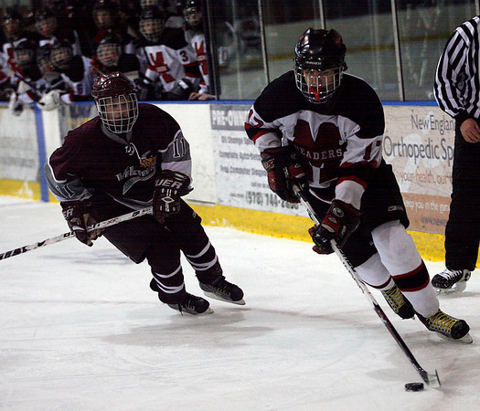 Salem: Marblehead's Alex Whitmore pulls ahead of Rockport's Brendan Douglass during the first round of the Division 3 North tournament at Salem State last night. Photo by Kate Glass/Salem News Thursday, February 26, 2009