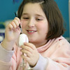 Gloucester: Molly Jenkins, 8, of Gloucester works on painting a ceramic egg at Glazed Ceramic Studio Friday afternoon.  Jenkins was there with some friends for a school vacation workshop. Mary Muckenhoupt/Gloucester Daily Times