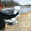 Manchester: Bill Fusco of Manchester paints a wintery landscape at the edge of Masconomo Park on Tuesday afternoon. Although ice still coated much of the water, it was warm enough to be out painting. Photo by Kate Glass/Gloucester Daily Times Wednesday, February 17, 2009