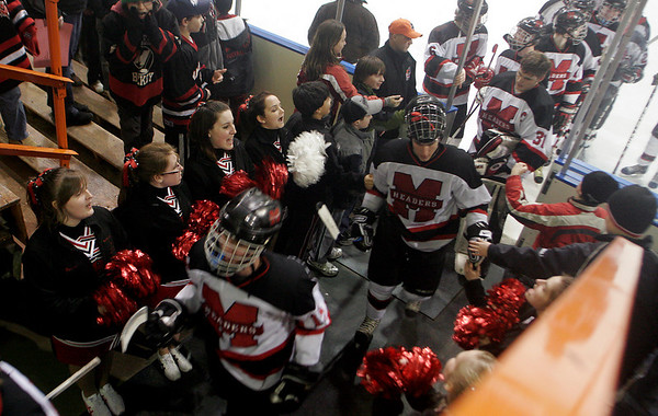 Salem: Fans cheer as the Marblehead boys hockey team comes off the ice after defeating Rockport 10-1 in the first round of the Division 3 North Tournament at Salem State last night. Photo by Kate Glass/Salem News Thursday, February 26, 2009