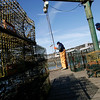 Manchester: Mark Power, left, and Alan Hill, right, unload lobster traps off the Capt. Yak in Manchester Harbor Tuesday afternoon. Hill says March is usually a bad month for lobstering. Photo by Kate Glass/Gloucester Daily Times Tuesday, February 17, 2009