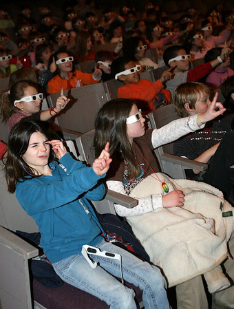"""Rockport: Rockport Elementary School students Meagan Smith, left, and Caroline Quirk, right, learn how 3-D glasses work before watching """"The 3-D Underwater World of Sampson the Frog Fish"""" narrated by Ed Jameson, who took the 3-D photos. Photo by Kate Glass/Gloucester Daily Times Tuesday, February 10, 2009"""