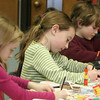 Gloucester: From left Hannah McCormick, 5, Aidan Cunningham, 7, and her brother Cole, 5, work hard on their Valentine's Day cards Saturday afternoon at the Sawyer Free Library.  The library held Valentine card making with Jesse Brown which gave kids a chance to make creative cards for their loved ones. Mary Muckenhoupt/Gloucester Daily Times
