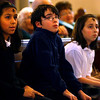 Gloucester: Gabriela Llanos, BJ Mohan, and Caylee DaSilva listen to the closing song during Ash Wednesday service at St. Ann's Church yesterday afternoon. The children, all students at St. Ann's School, delivered the readings for the service. Photo by Kate Glass/Gloucester Daily Times Wednesday, February 25, 2009