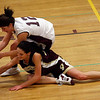 Gloucester's Hannah Cain and Westport Academy's Jen Normandie dive for a loose ball during the first round of the Division II North State Tournament at Westford Academy last night. Photo by Kate Glass/Gloucester Daily Times Monday, February 23, 2009