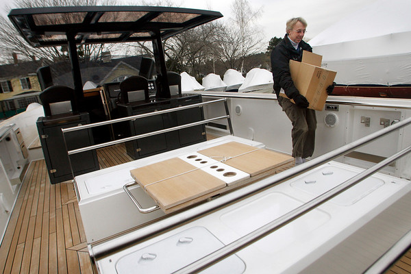 Manchester: Robert Wilcox of New Wave Yachts removes items from Crazy 8's, a 40 foot yacht, at Manchester Marine on Thursday afternoon. The yacht, which was built in Germany, was recently featured at the New England Boat Show in Boston. Photo by Kate Glass/Gloucester Daily Times Friday, February 26, 2009