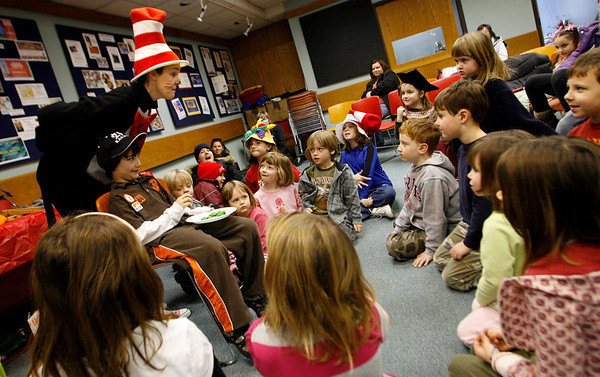Gloucester: James Nelson pretends to eat green eggs and ham as Carole Finn narrates the story dressed as the Cat in the Hat during a celebration of Dr. Seuss at the Sawyer Free Library on Saturday. The children learned about Dr. Seuss' life and heard parts of some of his most famous tales. Photo by Kate Glass/Gloucester Daily Times Saturday, February 21, 2009
