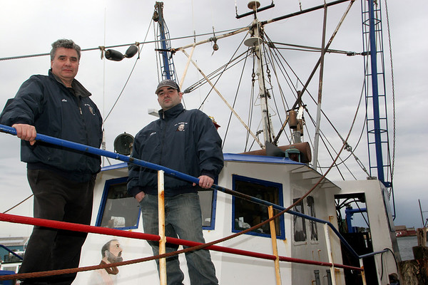 Gloucester: Joe Orlando and his son Mario stand on the bow of Padre Pio Thursday afternoon.  The Orlando's are among a number of Gloucester fishermen who are being blocked from fishing due to a suspension of leased Days at Sea.  Mary Muckenhoupt/Gloucester Daily Times