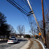 Essex: Essex residents have expressed concern over this utility pole that hangs over Eastern Avenue near Lufkin Road. Although the pole is attached to a sturdier one, they would like it replaced before it falls on a car. Photo by Kate Glass/Gloucester Daily Times Tuesday, February 24, 2009