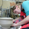 Manchester: Manchester Essex senior Hannah Gurley works on a the finishing touches of a clay bowl in Tamera Burns's art room Thursday afternoon.  Gurley is taking pottery as an idependant study since this is the forth time taking the class. Mary Muckenhoupt/Gloucester Daily Times
