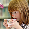 Essex: Anna Mayer, 3, of Essex takesd a sip of pink tea during the Valentine tea party held at the TOHP Burnham Library Friday afternoon.  Cupcakes, cookies and heart shaped finger sandwiches were served with raspberry tea and pink lemonade to the kids who were celebrating Valentine's Day as well as the start of February Vacation. Mary Muckenhoupt/Gloucester Daily Times