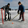 Gloucester: Charlotte Salmon, 9, fishes the puck out of the net as Griffin Penn, 8, looks on while playing pond hockey at Niles Pond yesterday afternoon. Photo by Kate Glass/Gloucester Daily Times Monday, February 16, 2009