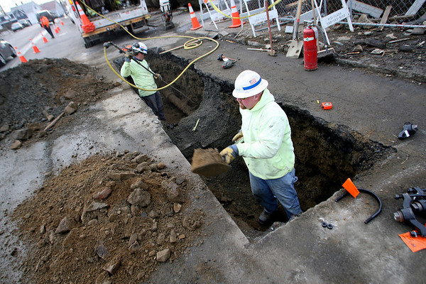 Gloucester: National Grid employees dig out the gas line in front of 76 Eastern Ave yesterday, which exploded last month, in preparation to remove the cracked section of pipe today. Photo by Kate Glass/Gloucester Daily Times Wednesday, February 11, 2009