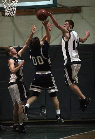 Manchester: Manchester Essex's Brian Ciccone blocks a shot by Hamilton-Wenham's Isaac Carp last night. Photo by Kate Glass/Gloucester Daily Times Tuesday, February 3, 2009
