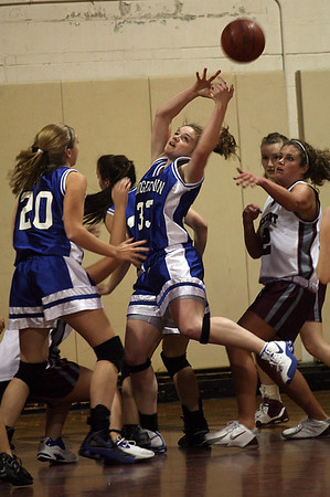 Georgetown's Taryn O'Connell tries to pull in a rebound during their game against Rockport last night. O'Connell is on the brink of 1,000 career rebounds. Photo by Kate Glass/Newburyport Daily News Tuesday, February 10, 2009