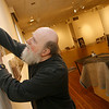 Gloucester: Paul Miller hangs photos by Gloucester Times Photographer Charlie Lowe at the Cape Ann Museum. The exhibit opens March 7th. Photo by Kate Glass/Gloucester Daily Times Thursday, February 26, 2009