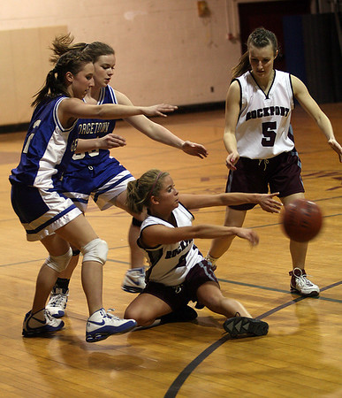 Rockport's Katelyn Keough scoops up a loose ball from Georgetown's Maria DeGenova and Taryn O'Connell as teammate Hannah Evans looks on during their game against Georgetown last night. Photo by Kate Glass/Gloucester Daily Times Tuesday, February 10, 2009
