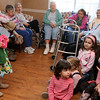 Gloucester: Cameron MacDonald and her classmates from Majestic Preschool visit seniors at Golden Living yesterday afternoon. The girls dressed up as angels for Valentines Day and sang songs to the residents. Photo by Kate Glass/Gloucester Daily Times Monday, February 9, 2009