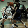 Manchester: Manchester Essex's Pat Orlando watches as Trinity Catholic's Daryl Thomas steals the ball during the first round of the Division 4 North State Tournament at Manchester Essex High School last night. Photo by Desi Smith/Gloucester Daily Times Tuesday, February 24, 2009