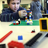 Rockport: Josh Sholes, 8, builds the legs of a giant LEGO dinosaur during an after school program at Rockport Elementary School on Monday. Sholes did not know what kind of dinosaur it was going to be, but said it would be huge. Photo by Kate Glass/Gloucester Daily Times Monday, February 9, 2009