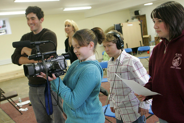 """Gloucester: Jaqui McCarthy films a scene with the help of classmates Peter Periera and Jessica Ingaharro, right, during a special class on movie making at the Gloucester Stage Youth Acting Workshop run by Heidi Dallin at the East Gloucester Community Church Saturday afternoon.  Filmmaker Oliver Horovitz, left, came to help teach the class and students got to read from scripts of movies made on Cape Ann. The scene being filmed here was from the movie """"The Proposal."""" Mary Muckenhoupt/Gloucester Daily Times"""