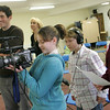 "Gloucester: Jaqui McCarthy films a scene with the help of classmates Peter Periera and Jessica Ingaharro, right, during a special class on movie making at the Gloucester Stage Youth Acting Workshop run by Heidi Dallin at the East Gloucester Community Church Saturday afternoon.  Filmmaker Oliver Horovitz, left, came to help teach the class and students got to read from scripts of movies made on Cape Ann. The scene being filmed here was from the movie ""The Proposal."" Mary Muckenhoupt/Gloucester Daily Times"