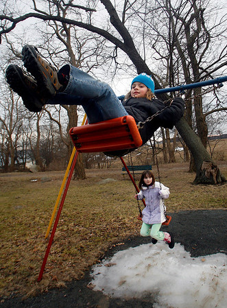 Gloucester: Sarah McQuaid, 7, swings as high as she can while out with her friend, Madison Laing, 8, at the Stage Fort Park playground on Thursday afternoon. Photo by Kate Glass/Gloucester Daily Times Thursday, February 26, 2009