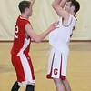 Gloucester: Gloucester's Dylan Maki looks to pass past Amesbury's David Miller during the basketball game held at Benjamin A. Smith Fieldhouse Wednesday night. Mary Muckenhoupt/Gloucester Daily Times
