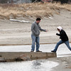 Gloucester: Josh List helps his friend Meagen Morse up onto the footbridge at Good Harbor Beach Thursday afternoon after walking the beach.  The water came so close to the bridge due to high tide and a full moon. Mary Muckenhoupt/Gloucester Daily Times