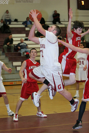 Gloucester: Chris Unis makes a layup during the basketball game against Amesbury at the Benjamin A. Smith Fieldhouse Wednesday night. Mary Muckenhoupt/Gloucester Daily Times
