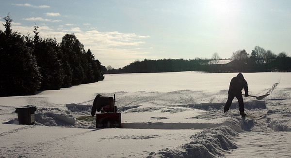 Manchester: An Essex County Club employee clears snow from the tees at their driving range Wednesday morning. Although it has been cold, the temperature is expected to reach 50 this weekend. Photo by Kate Glass/Gloucester Daily Times