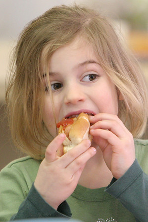 Manchester: Lydia Shaw, 5, of Manchester takes a big bite of her ketchup covered hot dog at the Frank Fest held at the First Parish Chapel Saturday.  The fest offered a variety of foods as well as live music, a hot diggity dawg quiz, hair wraps and face painting. Mary Muckenhoupt/Gloucester Daily Times