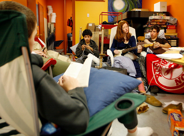 Gloucester: From left: Alex Henry reads, Nathan Rubin knits, Emily Farel strums a guitar and Brenden Henry drinks a soda as they try to stay awake during the Cape Ann YMCA's annual Rock-A-Thon at the YMCA Teen Center yesterday. Participants rocked from 8 a.m. yesterday to 8 a.m. this morning and were allowed several 10 minute breaks. The 24 participants brought their own rockers and collected cans of food to donate to the Cape Ann Food Pantry. Over 2,400 cans have been collected so far and the Teen Center will continue accepting donations until March. Photo by Kate Glass/Gloucester Daily Times Tuesday, February 17, 2009