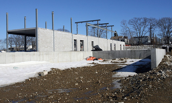 Gloucester: The wall and delivery area for Market Basket at the Gloucester Crossing site are up despite efforts from local residents who are suing the City of Gloucester over its refusal to accept their petition to rescind the vote approving a tax deal with developers. Photo by Kate Glass/Gloucester Daily Times Monday, February 9, 2009