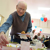 Manchester; Vin Terrill of Manchester scoops up some mustard to put on his hot dog at the Frank Fest held at the First Parish chapel Saturday.  This all you can eat family fest included hot dogs and veggie hot dog as well as salads, side dishes and plety of tasty deserts. Mary Muckenhoupt/Gloucester Daily Times